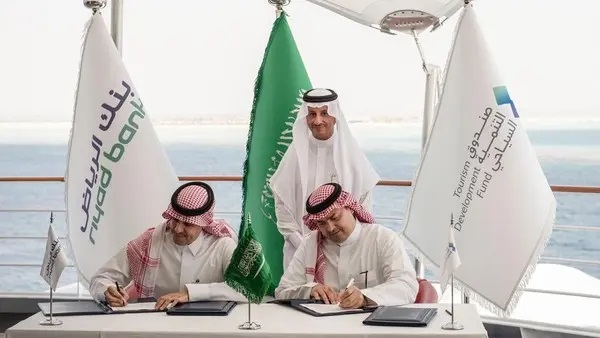 Representatives from Saudi Tourism Development Fund and Riyadh Bank sign a deal in the presence of Saudi Arabia's Tourism minister Ahmed al Khateeb.